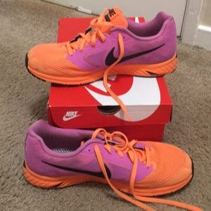 Pink and orange lightweight running shoes